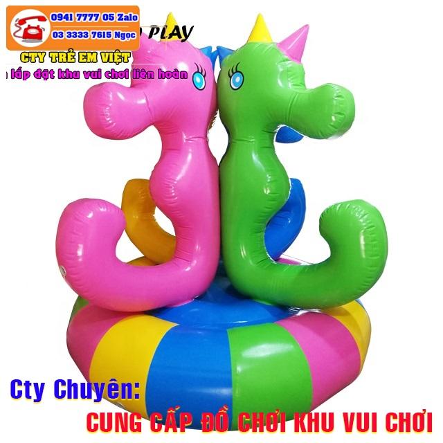 Mâm xoay điện bằng hơi đồ chơi mà các em khá thích trong khu vui chơi trẻ em.